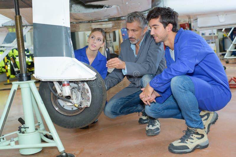 Avionics apprentice and teacher stock photo