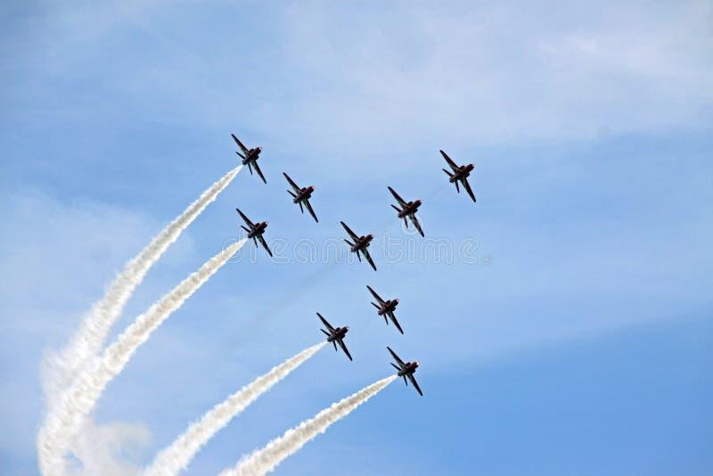 Avions à réaction acrobatiques aériens de l'Armée de l'Air rouge de la flèche RAF image stock
