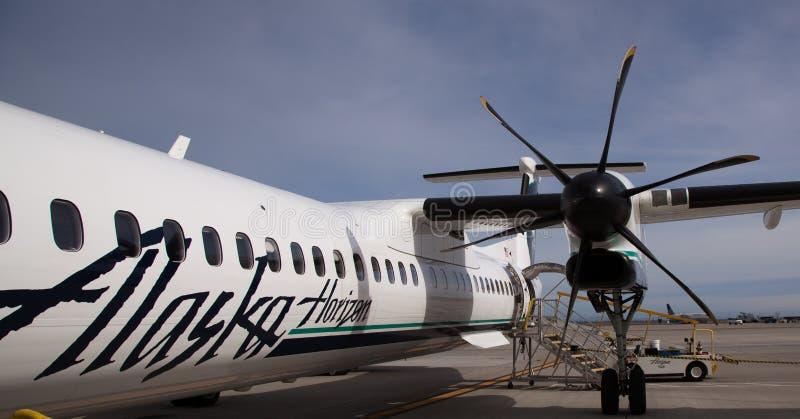Avions de Bombadier d'horizon de l'Alaska photographie stock