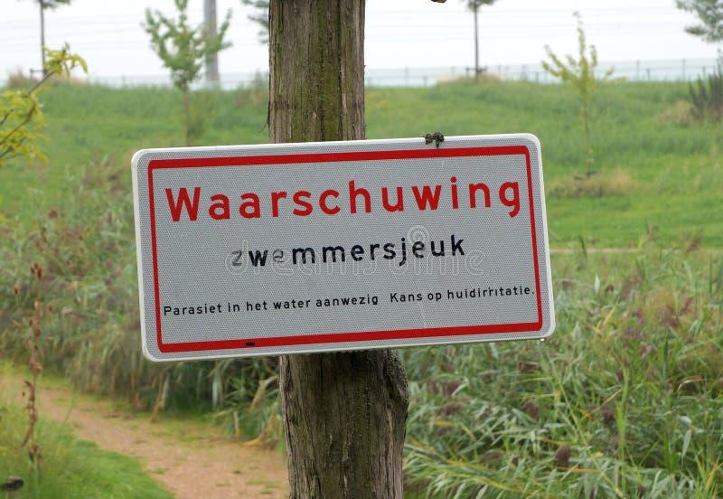Aviso holandês do sinal contra o comichão do ` s do nadador imagem de stock