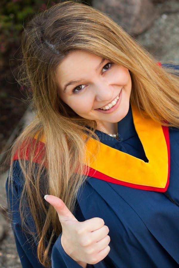 avlägga examen för flicka arkivfoton