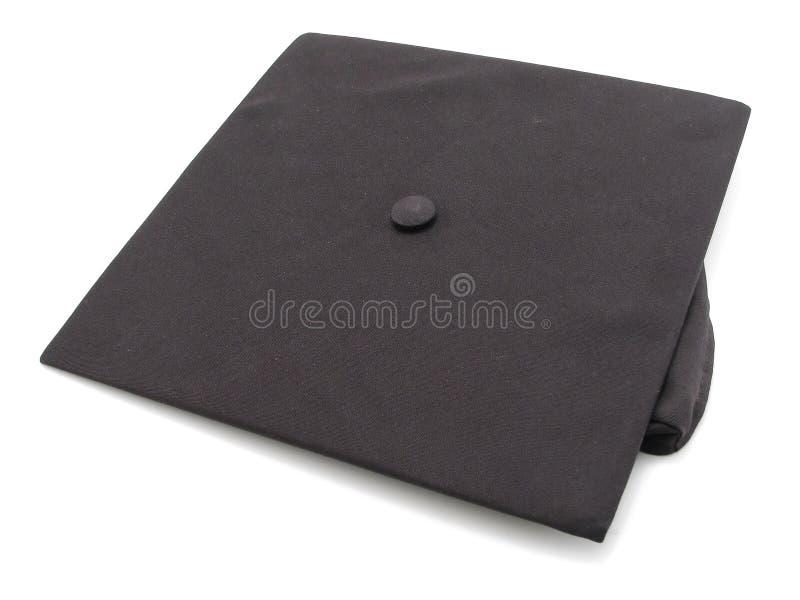 avläggande av examenmortarboard arkivbild