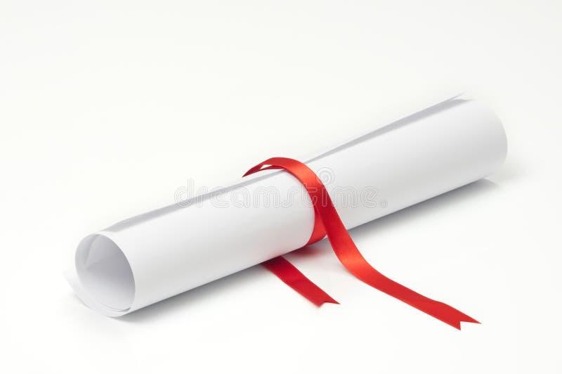 avläggande av examenscroll royaltyfri bild