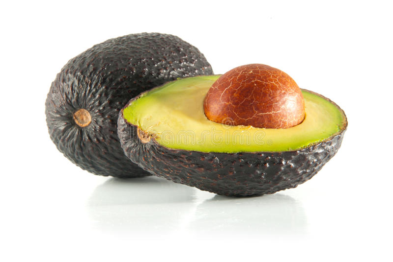 Avocado. Isolated fresh avocado cut in half with seed