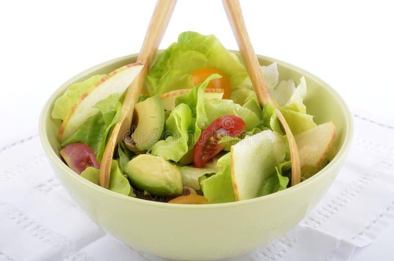 Avocado apple cherry tomato salad stock photography