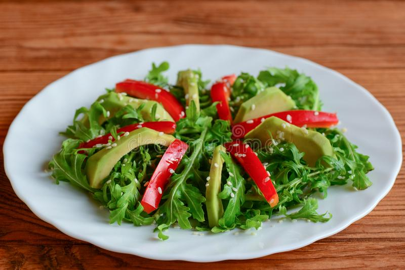 Avocado arugula and pepper salad on a white plate simple arugula download avocado arugula and pepper salad on a white plate simple arugula and avocado forumfinder Images
