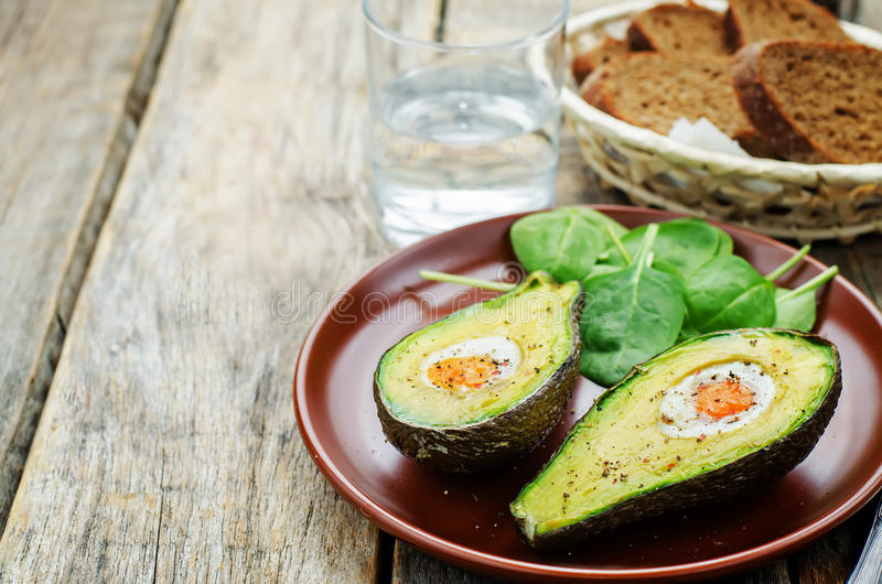 Download Avocado baked with egg stock image. Image of gastronomy - 50390923
