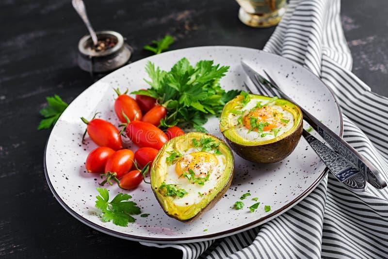 Avocado baked with egg and fresh salad. Vegetarian dish. Ketogenic diet. Keto food stock photo