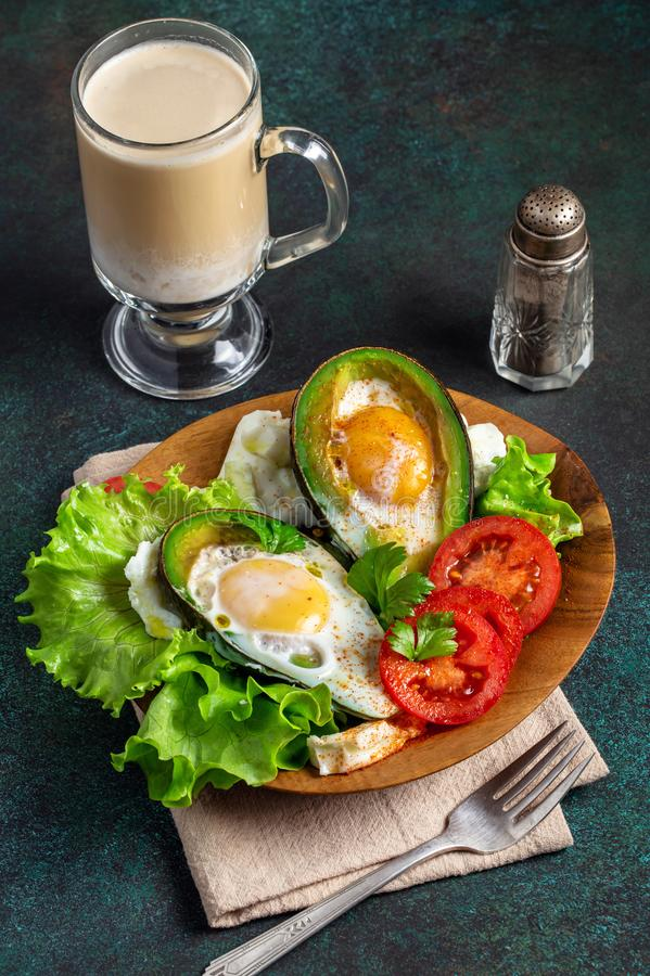 Avocado baked eggs royalty free stock photos