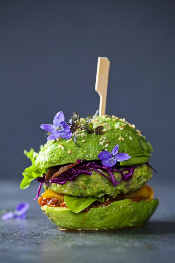 Download Avocado Burger With Green Patty Stock Photo - Image of flower, patty: 117594618