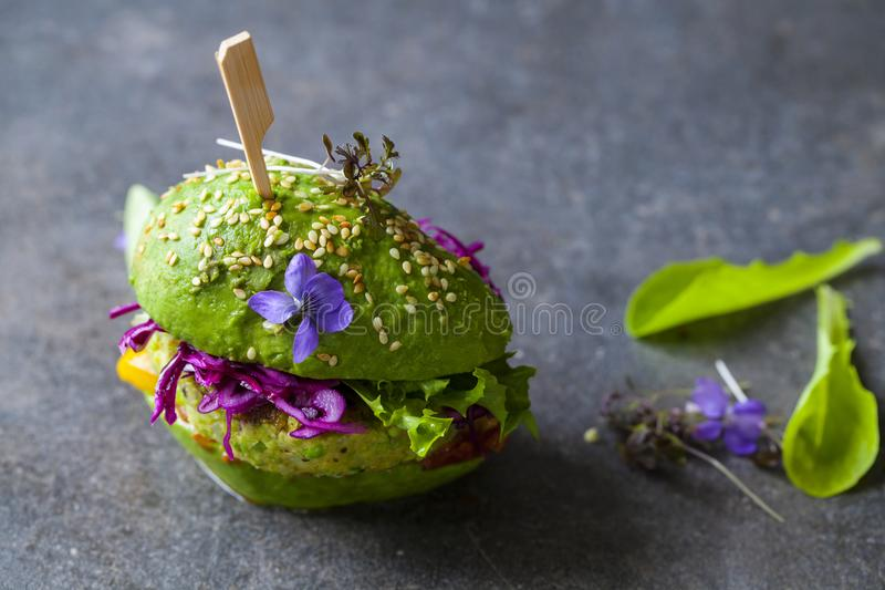 Download Avocado Burger With Green Patty Stock Photo - Image of trendy, colorful: 117594694