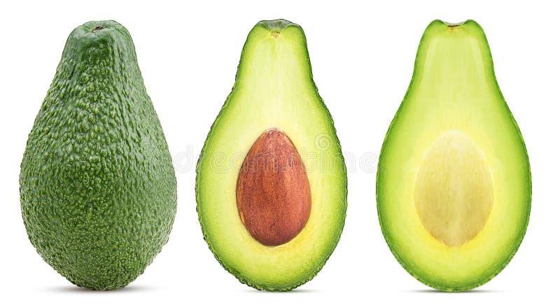 Avocado cały i rżnięty w połówce z kością zdjęcia royalty free
