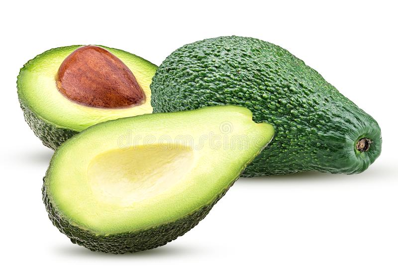 Avocado cały i rżnięty w połówce z kością zdjęcie stock