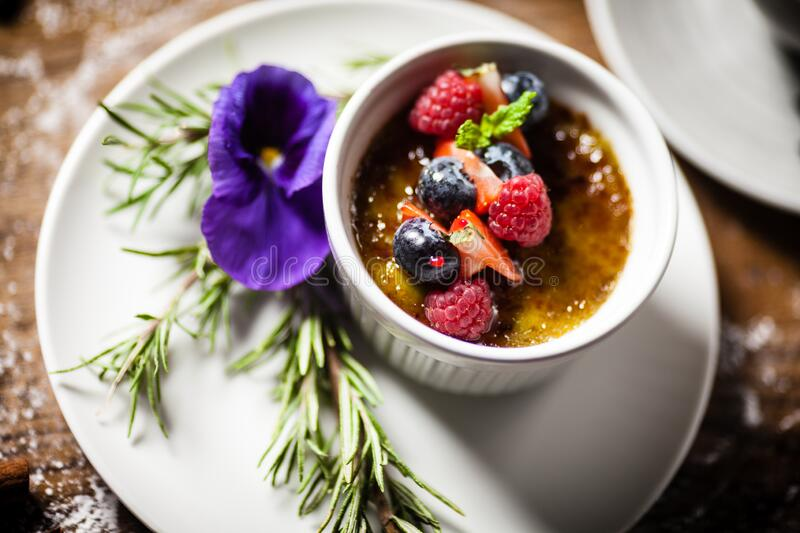 Avocado creme brulee served in a cup in restaurant royalty free stock image