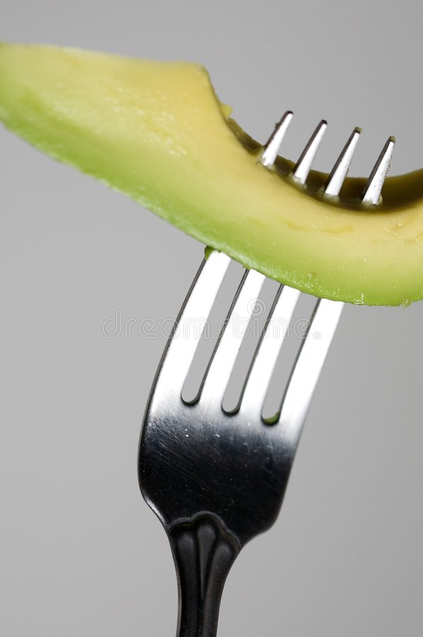 Avocado on a Fork stock photo