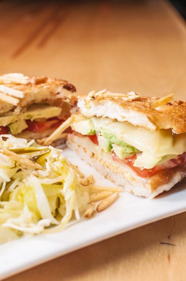 Avocado Gruyere Sandwich. A vegetarian panini with avocado, tomato, and gruyere cheese stock photos