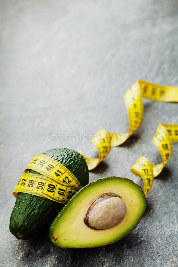 Free Avocado Half And Whole With Tape Measure On Black Background, Diet Concept Stock Image - 64905281