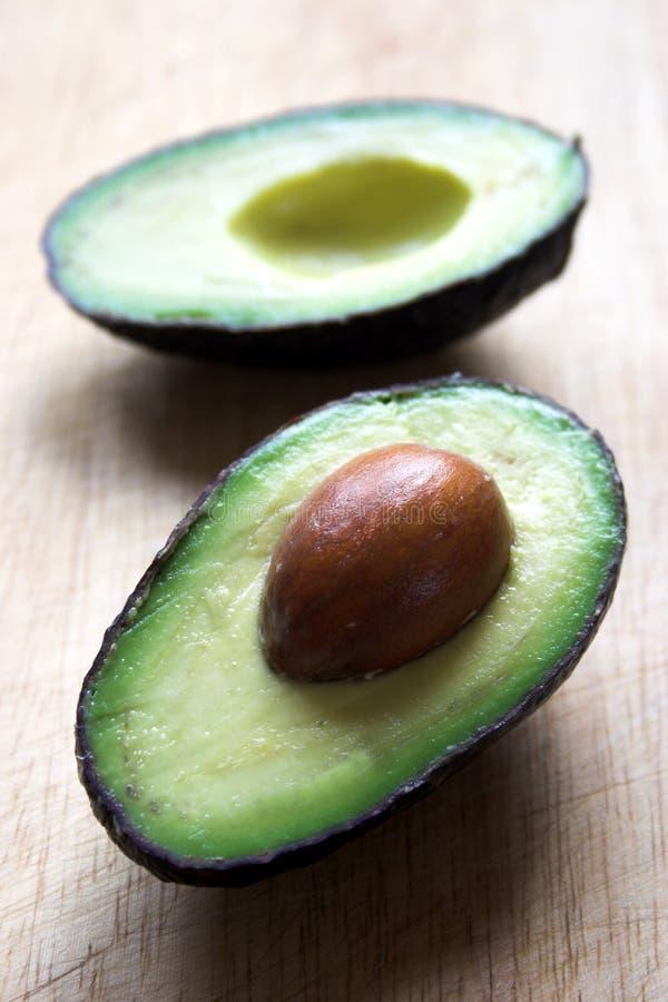 Avocado halves royalty free stock photography