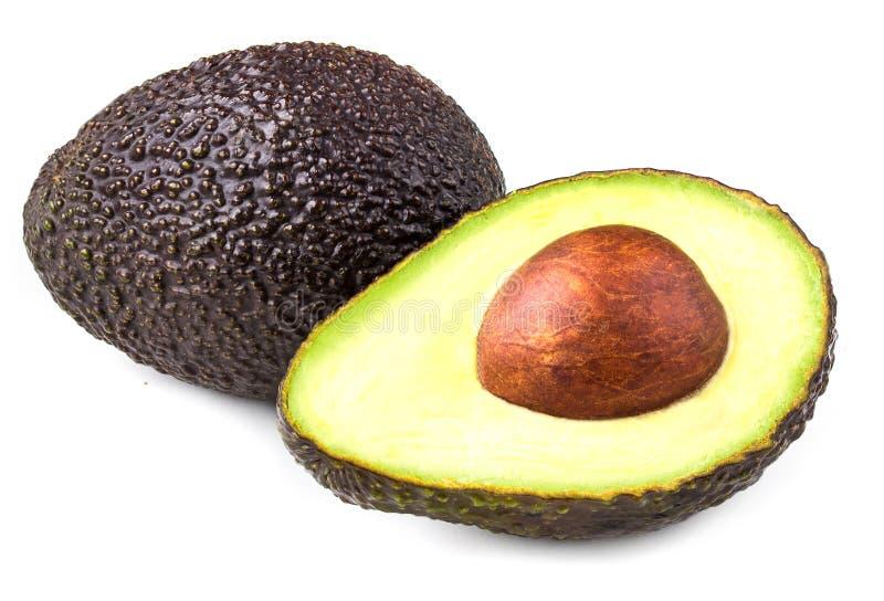 Avocado isolato su priorità bassa bianca Fine nera u di Haas dell'avocado immagine stock libera da diritti