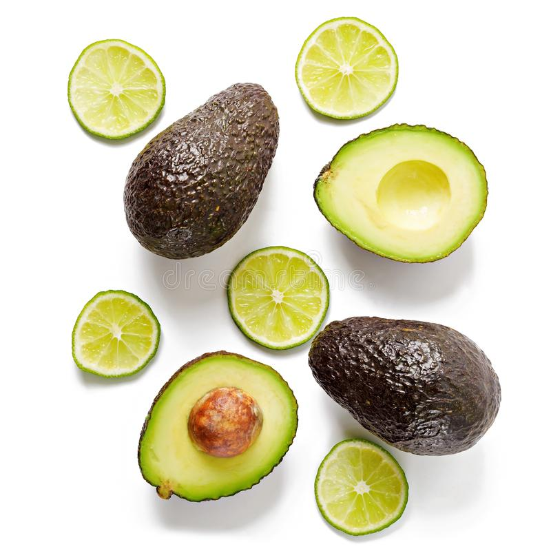 Avocado and lime isolated on white background. Top view royalty free stock photos