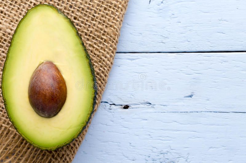 Image result for avocado on wooden table