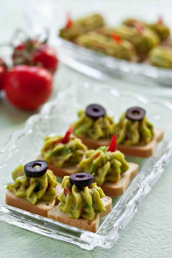 Avocado paste on toast. In a glass plate royalty free stock image
