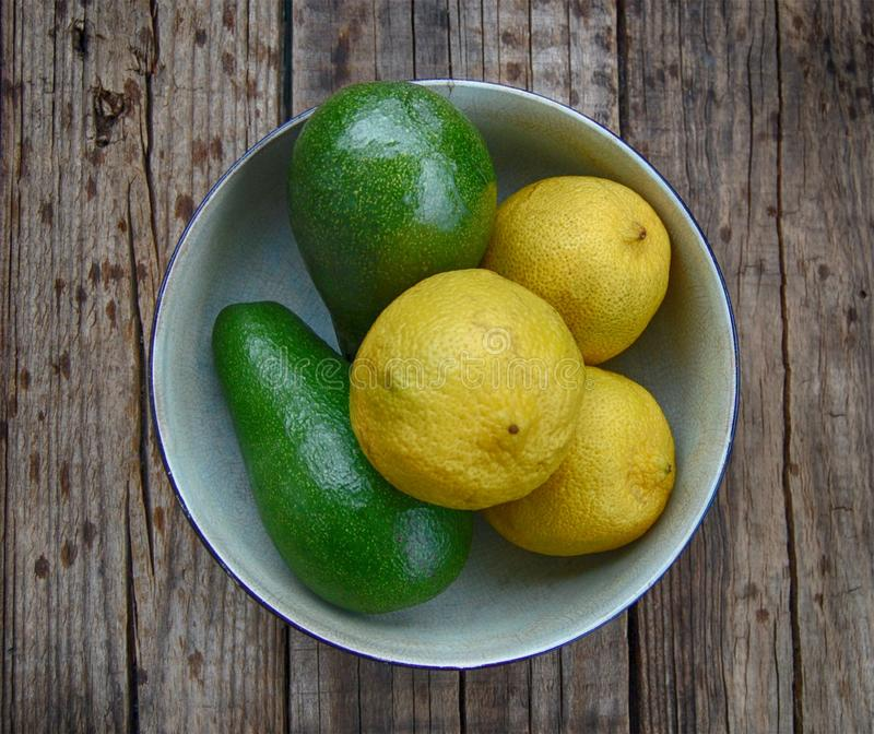 Avocado pears and lemons royalty free stock photos