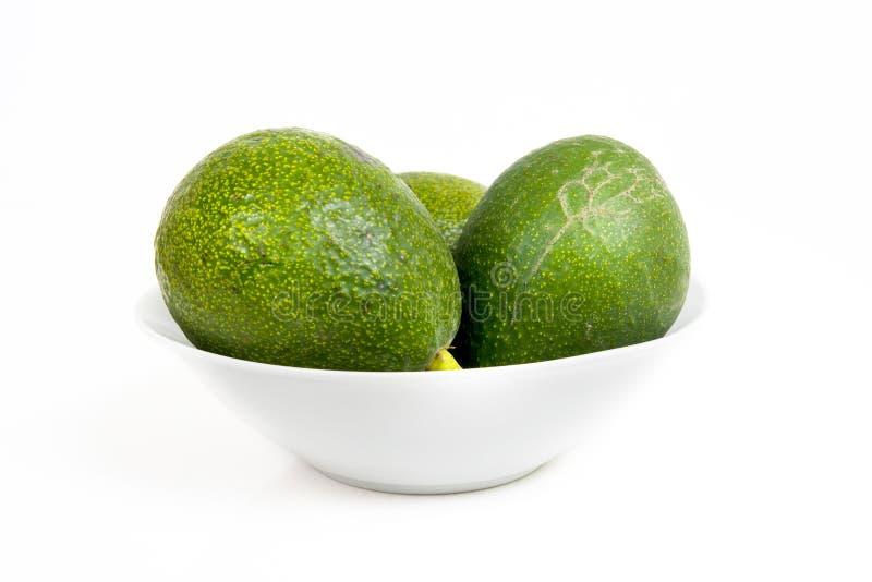Avocado's in een Kom stock afbeeldingen