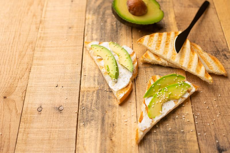 Avocado sandwiches, Philadelphia cheese with toast and sesame and avocado slices, morning breakfast, healthy and clean food, with. Space royalty free stock photography