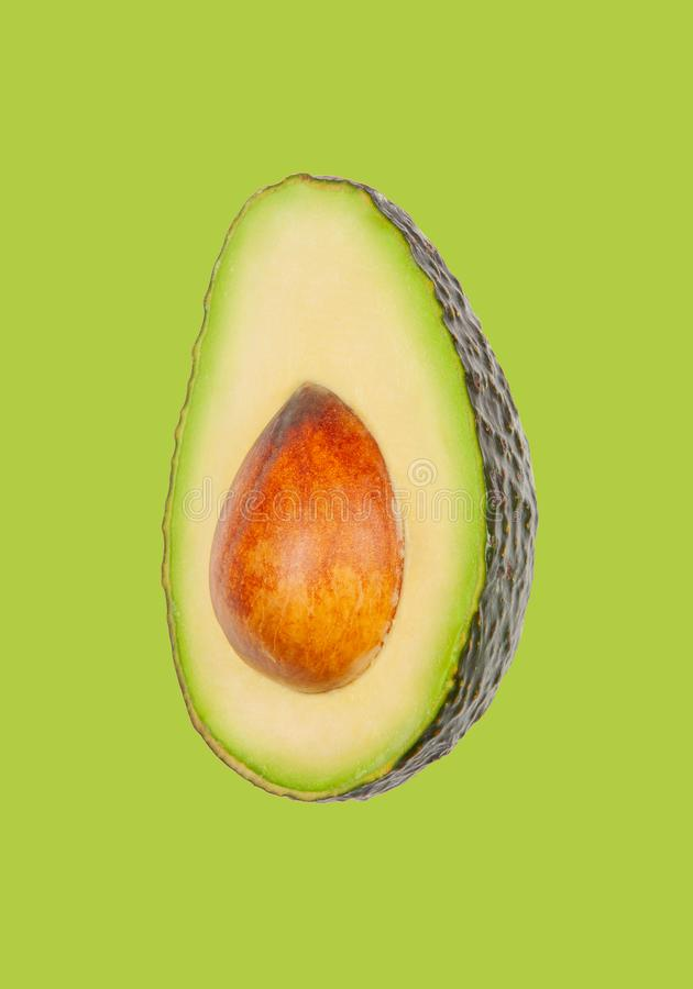 Avocado schweben in einer Luft auf gr?nem Pastellhintergrund frei Konzept der Gem?selevitation lizenzfreie stockbilder