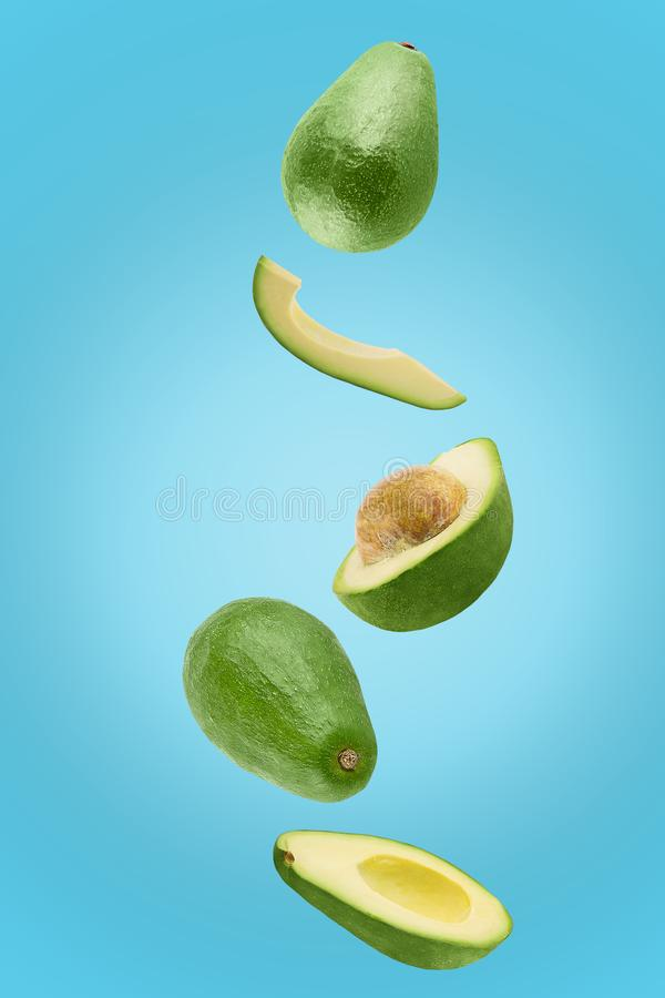 Avocado sliced isolated in blue background viewed from above royalty free stock photos