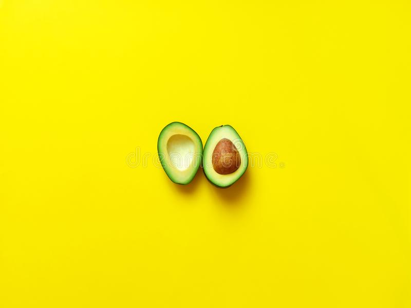 Avocado sliced with seed in yellow royalty free stock photos