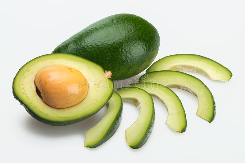 Avocado and slices. Avocado seed healthy eating super food health food berry portion stock photos