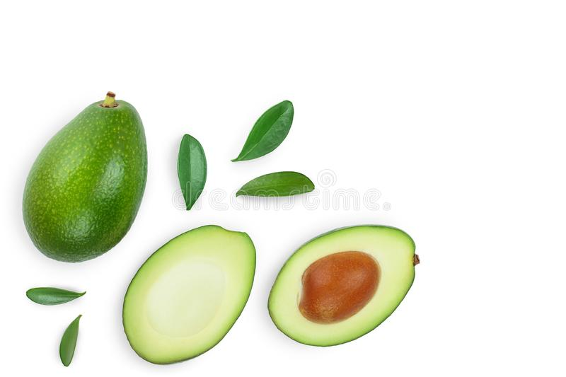 Avocado and slices decorated with green leaves isolated on white background with copy space for your text. Top view. Flat lay stock image