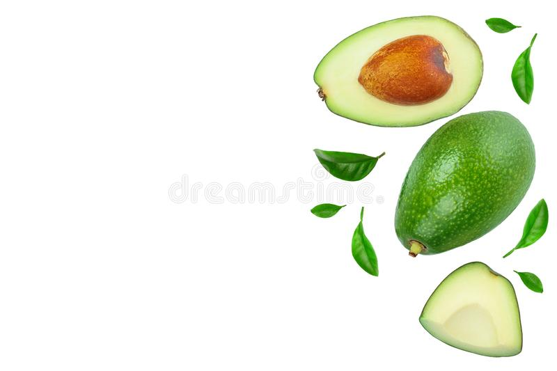 Avocado and slices decorated with green leaves isolated on white background with copy space for your text. Top view. Flat lay stock images