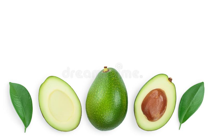 Avocado and slices decorated with green leaves isolated on white background with copy space for your text. Top view. Flat lay royalty free stock photo