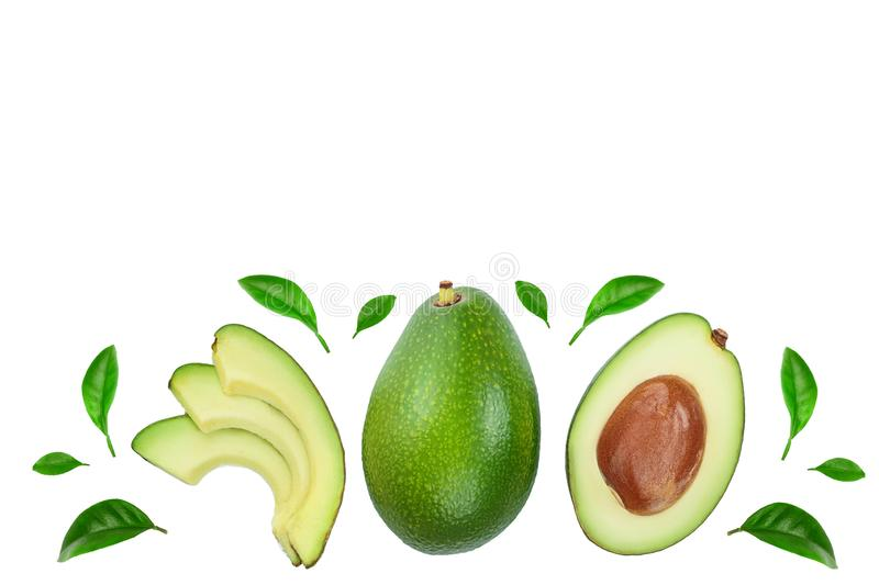 Avocado and slices decorated with green leaves isolated on white background with copy space for your text. Top view. Flat lay royalty free stock images