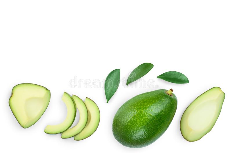 Avocado and slices decorated with green leaves isolated on white background with copy space for your text. Top view. Flat lay stock photos