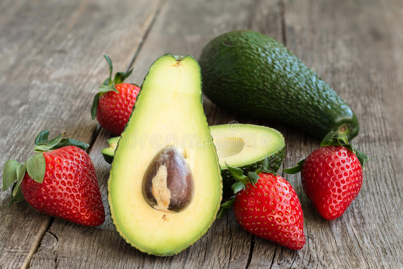 Avocado and strawberries royalty free stock image