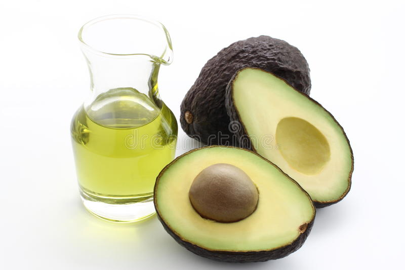 Avocado und Avocadoöl stockbild