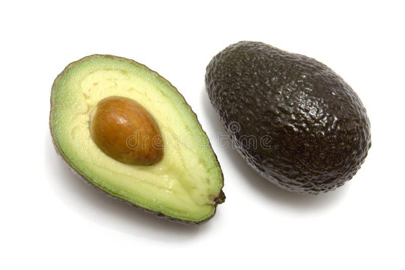 Avocado vollständig und halbiert lizenzfreie stockfotografie