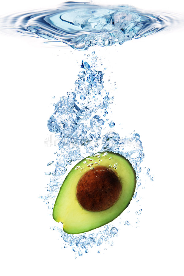 Avocado in water royalty free stock photography