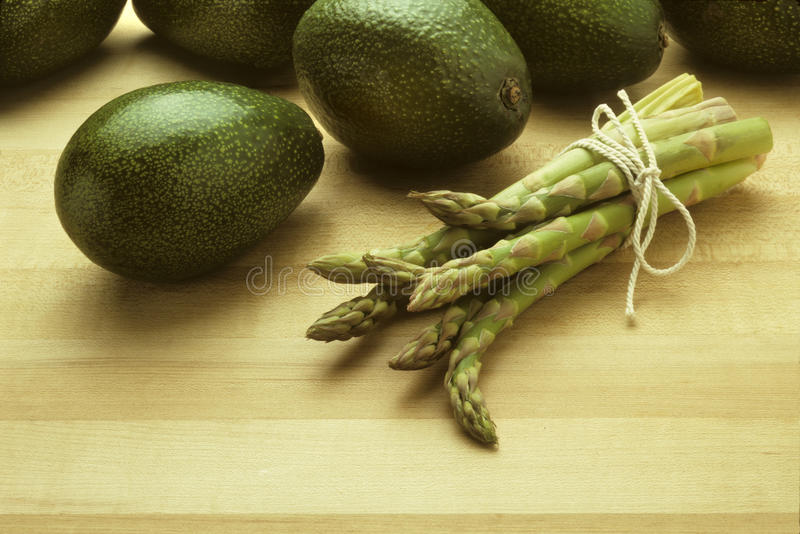 Download Avocados And Asparagus On Butcher Block Royalty Free Stock Images - Image: 10783999