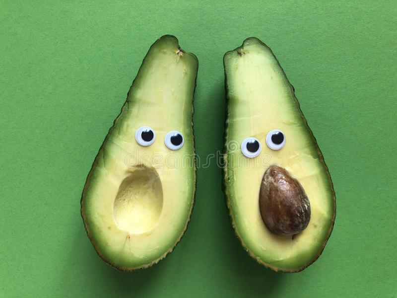 Creative funny food concept, avocados stock image