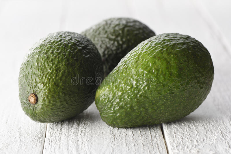 Avocados on a white background royalty free stock photo