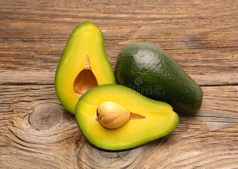 Avocados on a wood table royalty free stock images