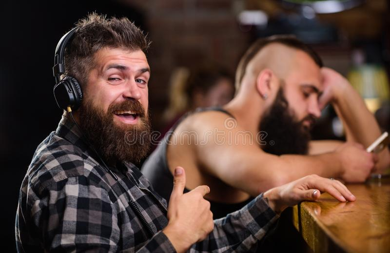 Avoid communication. Escape reality. Friday relaxation in bar. Hipster bearded man spend leisure at bar counter. Order. Avoid communication. Escape reality stock photo