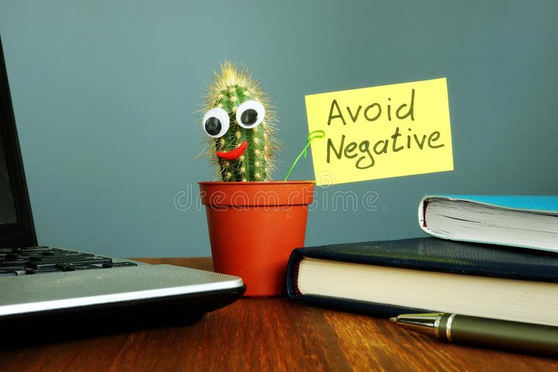 Avoid negative. Smiling cactus on the desk. Positive thinking. Concept royalty free stock photo