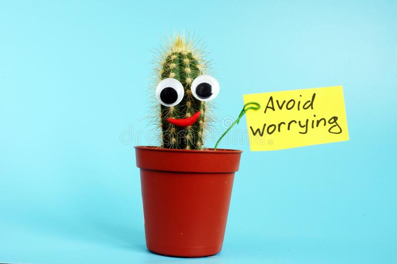 Avoid worrying sign and cactus. Stop stress concept. Avoid worrying sign and funny cactus. Stop stress concept stock photos