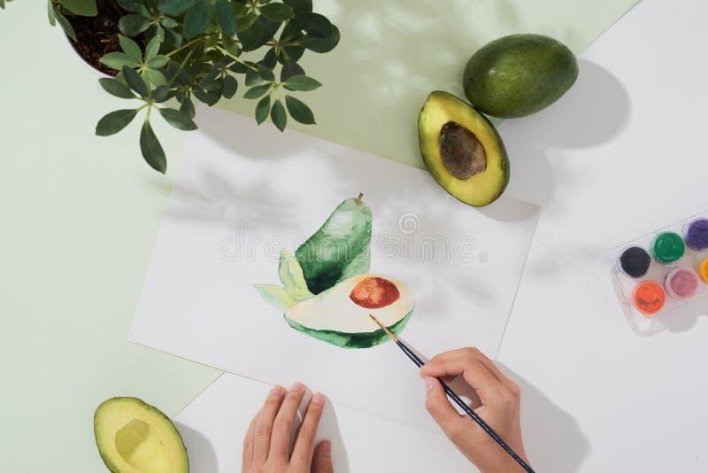 Avokado Tropiskt sommarbegrepp som göras av illustration för teckning för avokadofrukt och hand royaltyfri fotografi